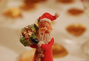 CLose-up of a Santa Claus figurine bearing a p...