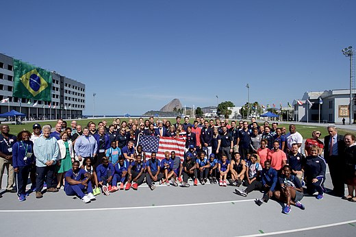 Secretary Kerry and his fellow presidential delegation members pose for a group photo with members of Team USA in Rio de Janeiro (28787760585).jpg