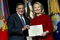 Secretary of Defense Leon E. Panetta presents former Secretary of State Hillary Rodham Clinton with the Department of Defense Medal for Distinguished Public Service during a ceremony in the Pentagon on Feb 130314-D-TT977-212.jpg
