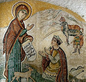 Mosaic depiction of Mary holding an Arabic tex...