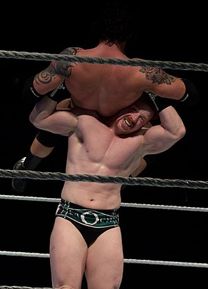 Powerbomb - Sheamus performing the High Cross on Wade Barrett.