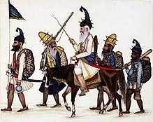 5 early Akali Sikh warriors, one carrying a flag, one on horseback.
