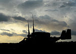 Silhoutte of a recently arrived Osprey in support of Operation United Assistance 141009-A-ZZ999-040.jpg