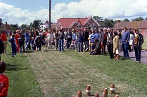Skittles (sport) - Traditional lawn skittles, played in Twyning Green, England, with pins resembling short candlepins