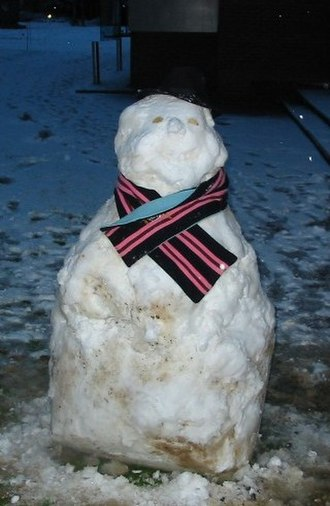 Academic scarf - This snowman has been dressed in a college scarf belonging to a member of Churchill College, Cambridge.