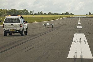 Solar car - Sunswift IV and control vehicle during speed record attempts at HMAS Albatross.