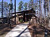 Visitor center surrounded by pine trees.