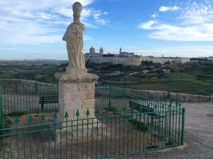 Temple of Proserpina - Statue of St. Nicholas and Mdina at far
