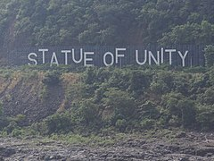 Image result for Statue of Unity sign board across the river.