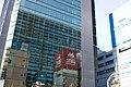 Sumitomo Fudosan Akihabara Building reflecting Taito and Sofmap signs - 2012-11-25 10.44.25 (by Keiichi Yasu).jpg
