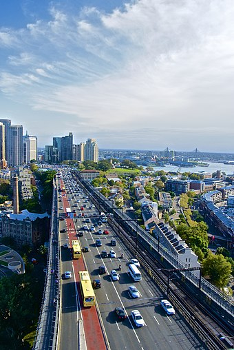 Sydney Harbour Bridge (southern approach shown) carries trains, motorised vehicles, cyclists and pedestrians Sydney Harbour Bridge Bradfield Highway.jpg
