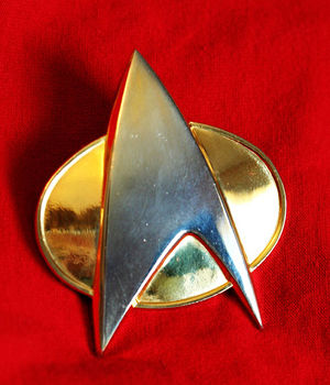 Communicator (Star Trek) - Starfleet communicator badge from The Next Generation and the early episodes of Deep Space 9.