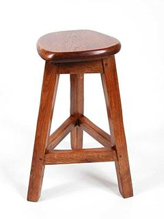 Stool (seat) item of furniture consisting of a single seat, for one person, without back or armrests, on a base of either three or four legs, generally distinguished from chairs by lack of arms and a back