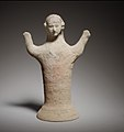 Terracotta statuette of a woman with raised arms MET DP101675.jpg