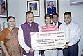 The Asian Junior Squash Champion (U-19) and the winner of British Junior Squash Open, Ms. Joshna Chinappa receiving a cheque from the Union Minister for Youth Affairs and Sports, Shri Sunil Dutt in New Delhi on April 15, 2005.jpg