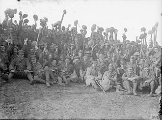 50th (Northumbrian) Division - Troops of the 1/5th Battalion, Northumberland Fusiliers cheering after the attack on Le Sars. Near Albert, 7 October 1916.