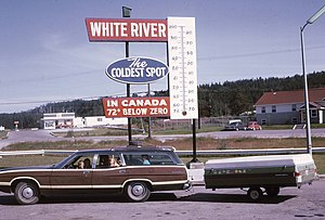 """White River, Ontario - A highway sign in 1973 promoting White River as the """"Coldest Spot in Canada""""."""