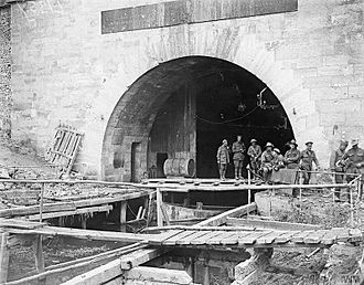 Battle of St Quentin Canal - Soldiers of the 30th American Infantry Division and the 15th Australian Brigade (5th Australian Division) at the southern entrance of the Bellicourt Tunnel at Riqueval near Bellicourt. It was captured by the 30th American Division on 29 September 1918. (Photographed 4 October 1918).
