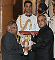 The President, Shri Pranab Mukherjee presenting the Padma Bhushan Award to Dr. Vijay Bhatkar, at a Civil Investiture Ceremony, at Rashtrapati Bhavan, in New Delhi on April 08, 2015.jpg