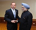 The Prime Minister, Dr. Manmohan Singh meeting the Prime Minister of Australia, Mr. Tony Abbott, on the sidelines of 11th India-ASEAN Summit and the 8th East Asian Summit, at Brunei Darussalam on October 10, 2013.jpg