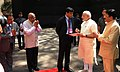 The Prime Minister, Shri Narendra Modi being received by the Governor of Reserve Bank of India, Shri Raghuram Rajan at the Financial Inclusion Conference of RBI, in Mumbai on April 02, 2015.jpg