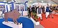 The Prime Minister, Shri Narendra Modi visiting the Make in India Theme Exhibition, at Naya Raipur, Chhattisgarh on November 01, 2016. The Chief Minister of Chhattisgarh, Dr. Raman Singh is also seen (2).jpg