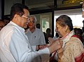 The Union Minister for Information and Broadcasting, Smt. Ambika Soni being welcomed by the Assam Minister of Law, Shri Pranab Gogoi, on her arrival at LGBI Airport, in Guwahati on July 12, 2010.jpg