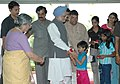 The children from All India Balmiki Vikas Samaj Parishad tying 'Rakhi' to the Prime Minister, Dr. Manmohan Singh, on the occasion of 'Raksha Bandhan', in New Delhi on August 09, 2006.jpg