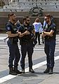 Three Italian police officers relaxing in Piazza del Duomo, Milan.jpg