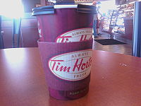 A photo of a Tim Horton's cup of coffee. Inten...