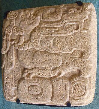 Itzamna - A Classic Period glyph with a representation of Itzamna with the body of a bird, found in the Plaza of the Dead Sun in Toniná and now in the site museum.
