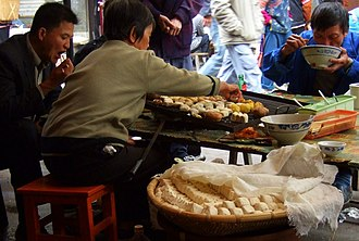 Tofu - Tofu and potatoes grilled at a street stall in Yuanyang, Yunnan province, China