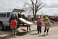 U.S. Air Force Senior Airman Clay Coppage, center, assigned to the 34th Combat Communications Squadron at Tinker Air Force Base, Okla., assists in the cleanup effort May 25, 2013, in Moore, Okla 130525-Z-VF620-4090.jpg