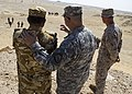 U.S. Army Maj. Gen. Robert Catalanotti, center, and Marine Corps Lt. Col. Kevin Collins, right, the commanding officer of Combat Logistics Battalion 26, 26th Marine Expeditionary Unit, discuss bilateral training 130429-M-HF949-013.jpg