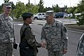 U.S. Army Maj. Gregory Sakimura, right, operations officer assigned to the 1st Battalion, 17th Infantry Regiment, 2nd Brigade Combat Team, 2nd Infantry Division, welcomes Republic of Korea Army Lt. Col. Choi Jae 130605-A-GP421-138.jpg