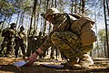 U.S. Marine Corps 2nd Lt. Benjamin Ryan, right, Bravo company, The Basic School (TBS), delivers a mission brief prior to conducting a patrol to ambush field exercise at Camp Barrett, Marine Corps Base Quantico 140313-M-RO295-064.jpg