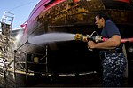 U.S. Navy Aviation Ordnanceman 3rd Class Emily Blonski, assigned to the aircraft carrier USS George Washington (CVN 73), washes the hull of a carapantia lightship during a community service project as part 130731-N-BD107-049.jpg
