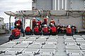 U.S. Sailors aboard the guided missile cruiser USS Philippine Sea (CG 58) prepare for a replenishment at sea in the Atlantic Ocean Dec. 10, 2013 131210-N-PJ969-066.jpg