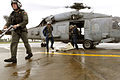 U.S. Sailors assigned to the Ronald Reagan Carrier Strike Group step off an HH-60H Seahawk helicopter assigned to Helicopter Anti-Submarine Squadron 4 upon their arrival to Kalibo, Philippines, June 2, 2008 080629-N-HX866-002.jpg