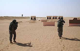 Live fire exercise - Small arms live-fire training, simulating advancing upon an enemy compound at Camp Buehring, Kuwait, 2009.