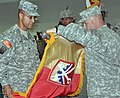 US Army 52520 Col. Martin Pitts, 16th Sustainment Brigade commander and Command Sgt. Maj. James Spencer, 16th SB senior noncommissioned officer, case their unit's colors at transfer of authority ceremony which offi.jpg