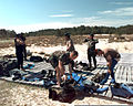 US Army Airborne personnel change into wetsuits before an airborne operation water jump from a helicopter at Fort Story, Virginia, 14 May 1997 970514-A-AZ979-008.jpg