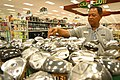 """US Navy 021028-N-3228G-006 Golf Pro Shop employee at the newly opened Navy Exchange located in the """"Mall at Pearl Harbor"""".jpg"""