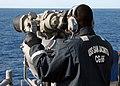 US Navy 021103-N-3235P-508 Sailor looks through the binoculars.jpg