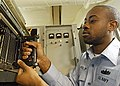 US Navy 030523-N-1512S-033 Fire Controlman 3rd Class Andre Holt checks his equipment.jpg