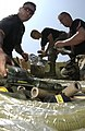 US Navy 030529-N-5862D-174 Explosive Ordnance Disposal Technicians prepare a clean-up.jpg