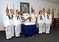 US Navy 030530-N-5576W-007 Vice Adm. Gerald L. Hoewing, Chief of Naval Personnel, Reviewing Officer for a recent recruit graduation, helps cut the cake with the recruit honor grads during the honor grad reception at Recruit Tra.jpg