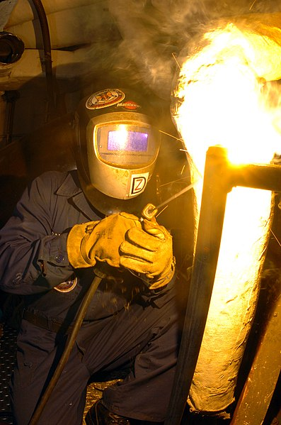 File:US Navy 040220-N-8197M-002 Hull Maintenance Technician Fireman Clifford Salvatore, of Flat Rock, Mich., welds safety rails in the engineering spaces aboard the amphibious command ship USS La Salle (AGF 3).jpg