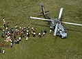 US Navy 050116-N-3823K-133 An SH-60B Seahawk helicopter lands to drop off relief supplies to Tsunami victims on the island of Sumatra, Indonesia.jpg