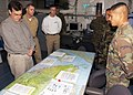 US Navy 050122-N-6074Y-005 U.S. Ambassador to Singapore, the Honorable Frank Lavin, left, listens to a logistics brief from a field doctor in the carrier intelligence center (CVIC).jpg